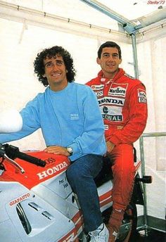 If you are a fan of F1 you have gotta luv this picture! Alain Prost and Ayrton Senna on a Honda MC! :)