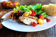 Pioneer Woman's Bruschetta Chicken - bruschetta topping heaped on grilled or sauteed chicken.  Looks so yummy.
