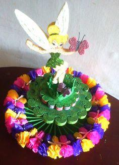 Facebook: GLOBOS Y MANUALIDADES (la del payasito fondo naranja. *Bombonera y bombones decorados (flores)*
