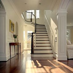 staircase. May want to do this at the new house.  Just stain the tops then paint the fronts white.