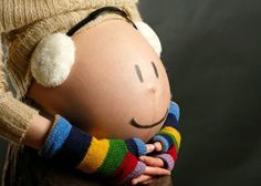 silly-baby-bump-picture-idea-with-earmuffs-fin.jpg 700×500 pixels