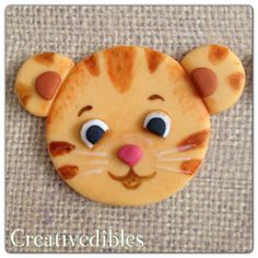 Daniel Tiger Fondant cupcake topper available from etsy. These look easy enough to make.