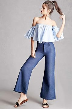 A pair of chambray pants by Korirl™ featuring a flared leg, zip fly, a front pleated design, and two back pockets.