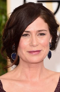 Maura Tierney Photos Photos - Actress Maura Tierney attends the 72nd Annual Golden Globe Awards at The Beverly Hilton Hotel on January 11, 2015 in Beverly Hills, California. - Arrivals at the Golden Globe Awards — Part 2