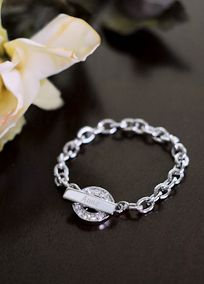 zOur Personalized Rhinestone Toggle Bracelet is absolutely darling. This rhodium finished bracelet featuring a circular rhinestone toggle charm is an excellent gift for all the women on your list. Whether youre dressing up or dressing down this sparkling bracelet will look fabulous with all your clothing options. May be engraved with a name, for my bridesmaids