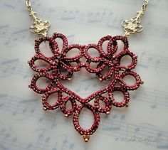Very pretty tatted lace heart pendant. Interesting thread too.