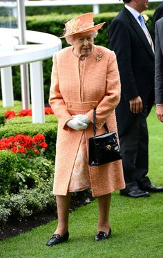 Pin for Later: The Queen's Got a Coat Set in Every Single Colour She Made Sure to Stand Out in This Orange Set