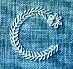 Monogram - C - Cute! All tight feather stitch with daisy at starting point. Beautifully done!