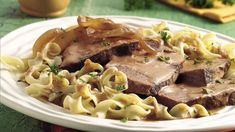 Slow Cooker Hungarian Beef Pot Roast: Come home to this spicy slow cooked beef roast that is served over noodles - perfect for a Hungarian dinner.