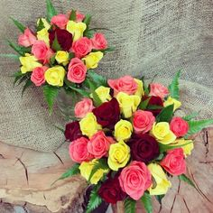 Mixed rose bouquets with leather fern accents