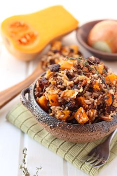 Spruce up your rice pilaf for fall with this Butternut Squash and Wild Rice Pilaf! A delicious whole-grain salad made with squash, almonds, cranberries and a simple balsamic vinaigrette for an easy dinner side dish or meal.