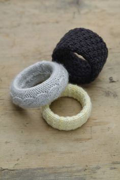 You're just making a knitted covering for bangle bracelets for these.  There is so much potential in this idea!  Must make!