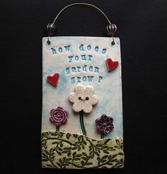 """Ceramic """"How does your garden grow?"""" wall plaque £13.00"""