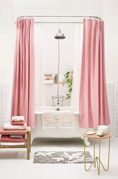 If you're not quite ready to splash out the pink paint, keep your all-white tiles and opt for accessories instead. This touch of color brings personality to any space, and there are lots of fun ways to introduce pink to your bathroom. Think: pendant light, shower curtains or even a set of towels.