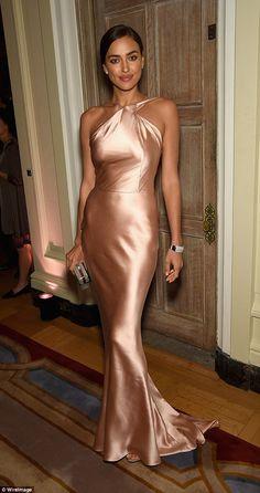 Simple in silk: Model Irina Shayk looked sensational in a pale pink, floor-length gown ...