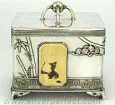 A sterling silver Tiffany Japanese motif tea caddy with removable lid.