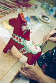 Hand-painted wooden horses are a tradition in Sweden. They were historically made as toys, but are also associated with Swedish folklore. The most popular design is in the traditional folk colours of red and green.