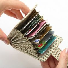 Finally - a credit card holder that fits credit cards, debit cards and store reward cards. And you can get them out of the slots! Need instructions!Buy a purse or card wallet and fill it with cash or gift cards. this accordian style wallet - it makes Fabric Crafts, Sewing Crafts, Sewing Projects, Sew Wallet, Wallet Tutorial, Creation Couture, Sewing Hacks, Sewing Patterns, Purses