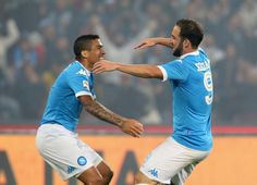 Allan and Gonzalo Higuain of Napoli celebrate during the Serie A match between SSC Napoli and Frosinone Calcio at Stadio San Paolo on May 14, 2016 in Naples, Italy.