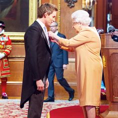 Eddie Redmayne is made an OBE (Officer of the Order of the British Empire) by Queen Elizabeth II during an investiture ceremony at Windsor Castle on December 2, 2016