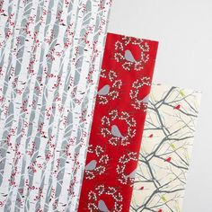 This exclusive set includes three loose sheets of kraft wrapping paper, featuring a cluster of woodland creatures including rabbits, reindeer, bears, raccoons, squirrels and owls.