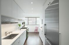 Using combinations of white, wood, and stainless steel, these unfussy kitchens prove that less is more.