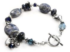 This gorgeous piece is one of our signature gemstone and sterling silver bracelets. Featuring sodalite in various shapes and sizes which is just lovely. Silver Charms, Sterling Silver Bracelets, Crystal Jewelry, Gemstone Jewelry, Jewelry Tags, Jewelry Ideas, Semi Precious Gemstones, Jewelry Collection, Swarovski Crystals