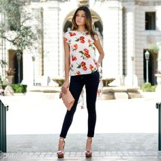 Floral top with an exaggerated sweeping draped back