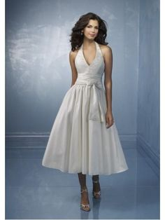 This Short Halter top Tea length Taffeta Sash Princess Designer wedding dress is good choice for beach wedding or any other informal wedding .   Fabric: Taffeta Embellishment:Sash Silhouette: A-line/Princess Neckline: Halter top Straps:Straps Sleeves: Sleeveless Hemline:Tea length Back: Zipper up $139.99