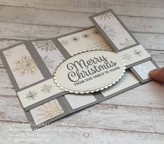 The unusual fold of this elegant Christmas card makes it truly special; not only is it a greeting card, but the recipient can enjoy it as a decoration as well. The bright, sparkly holiday colors and just a little bit of bling from the rhinestones make this a very dazzling card.