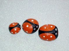 3 Ladybird beetle ladybugs orange white spring garden jewel moms garden dads garden hand painted rocks by Rockartiste on etsy. $18.00, via Etsy.