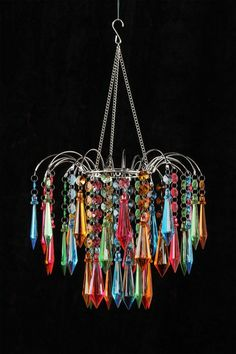"Rainbow Star Chandelier  by All that Shimmers Lighting   This remarkable chandelier is a brilliant way to define your classic style.  - Acrylic crystals  - Metal frame and arms  - Ready to hang  - Bulb not included   - Maximum wattage: 100 watt  - Cord: approx. 12 ft. length  - 12"" W x 12"" D x 11"" H  - Imported  $114.00"