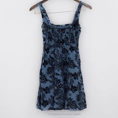 """Free People Floral Sundress Blue pull-on Free People sundress with black floral print design. 100% cotton. Skirt is lined. Elastic empire bust gives bodice shape. Approximately 31"""" long from shoulder strap to hem. Size is small. Please ask if you have questions. Free People Dresses"""