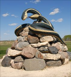 "The Inwood, MB Garter Snakes - ""Sam and Sara"".  The statue was constructed to make people aware of the Narcisse Snake Dens nearby. #exploremb"