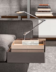 #furniture #sofas #living room - Integrated Seating and Surfaces by Minotti - White sofa detail. Kelvin LED Flos table lamp