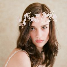 Twigs & Honey's blushing floral crown is reminiscent of cherry blossoms.