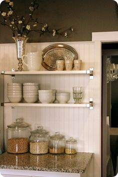 Glass containers on counter and shelves... loved my old kitchen!!
