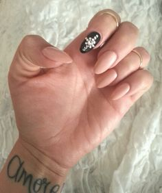 Nude with black crystal feature nail