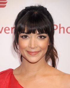"""""""Oval is the best face shape for bangs,"""" says Amy Bradbury of Kennaland salon in Brooklyn. A blunt style like Hannah Simone's will grab attention—to get the look, ask your stylist for straight bangs with a bit of texture at the ends. Heart Shaped Face Hairstyles, Face Shape Hairstyles, Hairstyles With Bangs, Bangs Hairstyle, Hairstyle Ideas, 1980s Hairstyles, Medium Hairstyle, Shaved Hairstyles, Spring Hairstyles"""