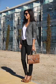 Blazer, white tee, black pants and heels.