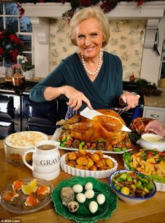 Festive feeling without fuss: Mary Berry's gets to carving following her own recipe to a perfect Christmas dinner