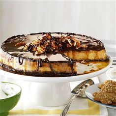 Gingerbread Cheesecake Recipe -This is my twist on Christmas gingerbread...cheesecake-style! I like to garnish it with small gingerbread men all the way around the sides and a dollop of whipping cream on each slice. —Cindy Romberg, Mississauga, Ontario