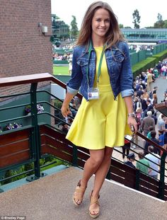 26 June 2013: Kim Sears arrives on court one to see watch Andy Murray's match against Yen-Hsun Lu in a pretty yellow dress