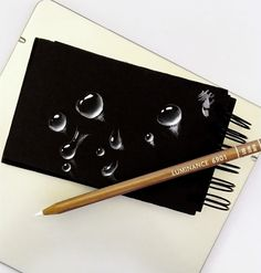 a quick sketch of different size and shape of a water drops, made with white pastel on black paper  #sketch #art #waterdrop #dropsketch #artwork #whitepastel #blackpaper #creative #sketching #quicksketch Art Drawings Sketches Simple, Pencil Drawings, Save Water Drawing, Black Paper Drawing, Color Crayons, Scratch Art, Old Cameras, White Pencil, Sketch Painting