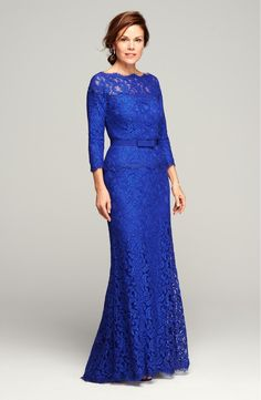 Free shipping and returns on Tadashi Shoji Illusion Lace Gown (Regular & Petite) at Nordstrom.com. The always-chic bateau-neck gown is elevated to black-tie glam in lavish floral lace that's left sheer at the yoke to create an off-the-shoulder effect. A tonal belt accentuates the waist and amplifies the silhouette's flowy, trailing finish.