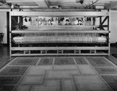 Studio Loja Saarinen weavers seated at one of the larger looms.  L to R: Elizabeth Edmark, Marie Bexell, Peggy Broberg, Gerda Nyberg.  May, 1935.  Cranbrook Archives.