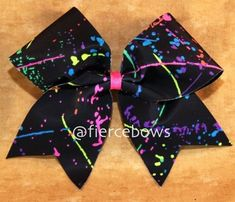 want to paint my room like this.well black with bright paint splatters<<< I know this is a bow, but like the comment, I want to do my walls like this! Softball Bows, Cheerleading Bows, Cheer Stunts, Cheer Dance, Cute Cheer Bows, Cheer Mom, Big Bows, Cheer Gifts, Paint My Room