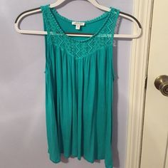 Charming Charlie green tank  PERFECT for spring and summer! Or even St. Patty's day! Soft tank with a lace collar. Beautiful green color! From Charming Charlie. Size MEDIUM but can also fit loosely on a SMALL! (I'm normally a small and this was a nice flowy top). Washed only according to care tag. NO TRADES. 100% rayon. Charming Charlie Tops Tank Tops