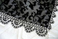 Tatted edging done with black thread attached to black sheer fabric - simply beautiful and so elegant. [link to the website does not work - unable to find the website - so this is for inspiration only]