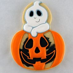 Here's a tutorial on how to add a ghost to any Halloween cookie using an acorn cookie cutter. Follow these steps to add some personality to your cookies.